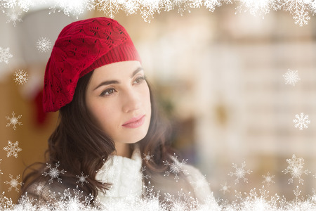 day dreaming: Portrait of a pretty brunette in day dreaming against fir tree forest and snowflakes Stock Photo