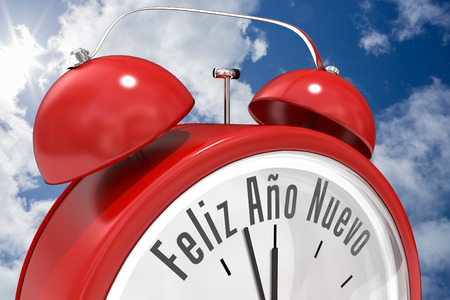ano: Feliz ano nuevo in red alarm clock against bright blue sky with clouds Stock Photo