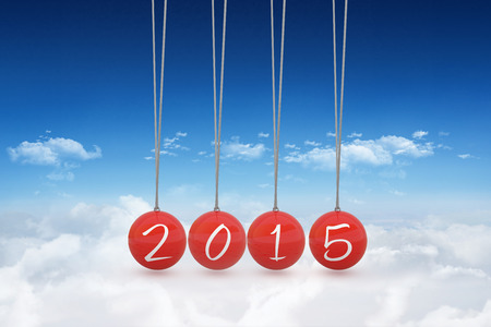 newtons cradle: 2015 newtons cradle against bright blue sky over clouds