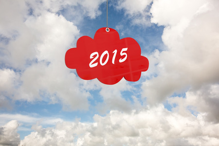 cloud tag: 2015 red cloud tag against blue sky with white clouds