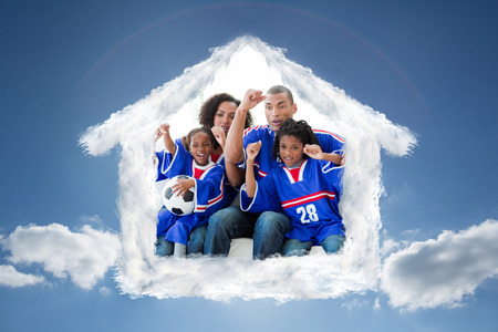cloudy home: Family celebrating a goal at home against cloudy sky with sunshine