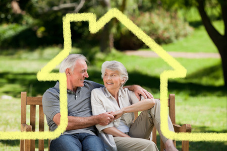 family and home: Senior couple sitting on a bench against house outline Stock Photo