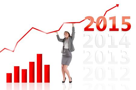 empujando: Empresaria empujando hacia arriba con las manos contra 2015