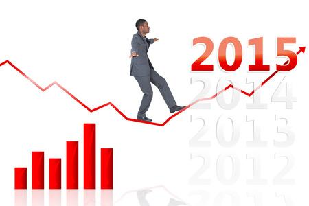 balancing act: Businessman performing a balancing act against 2015