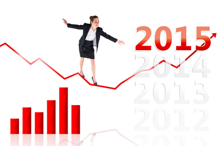 balancing act: Businesswoman performing a balancing act against 2015