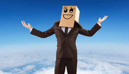 wonky: Anonymous businessman holding his hands out against blue sky over white clouds