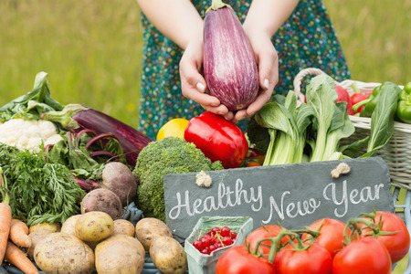 healthy women: Healthy New Year against vegetables at farmers market