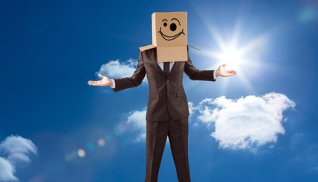 wonky: Anonymous businessman with hands out against bright blue sky with clouds