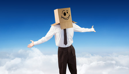wonky: Anonymous businessman with arms out against blue sky over clouds Stock Photo