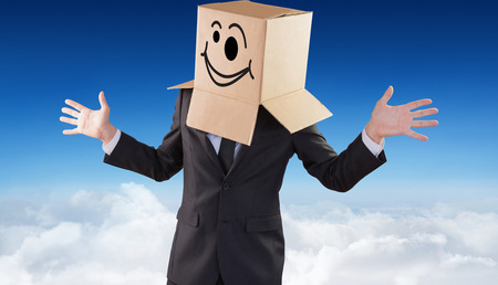 wonky: Anonymous businessman with hands out against blue sky over clouds