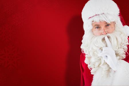 Portrait of santa keeping a secret against red snowflake background