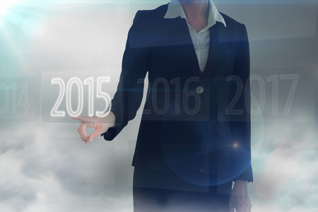 somewhere: Businesswoman pointing somewhere against 2015 on interface