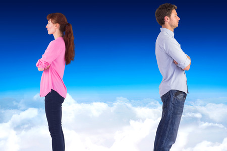 facing away: Man and woman facing away against blue sky over clouds Stock Photo