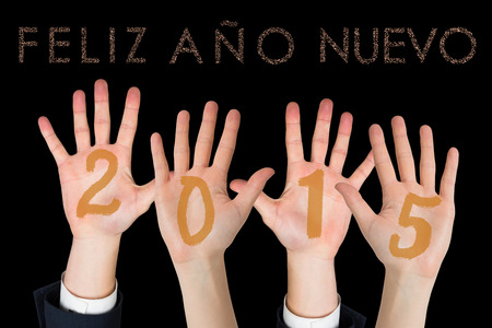 ano: Business peoples hands against glittering feliz ano nuevo