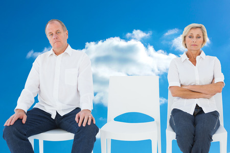 not talking: Upset couple not talking to each other after fight against cloudy sky Stock Photo