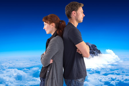 irritated: Irritated couple ignoring each other against mountain peak through the clouds