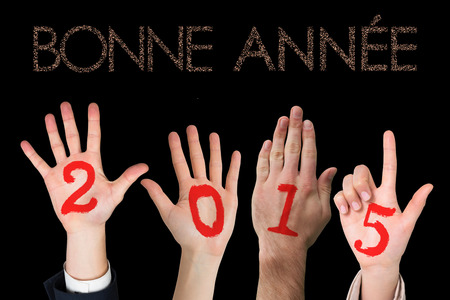 bonne: Hands against glittering bonne annee Stock Photo