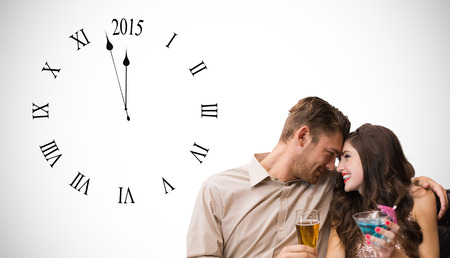 Cute couple drinking against white background with vignette
