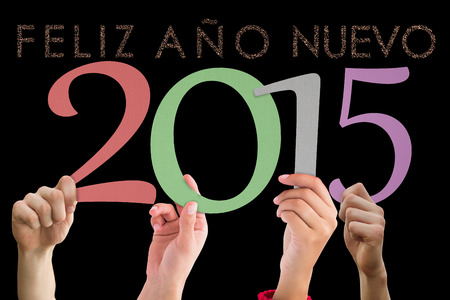 ano: Hands holding poster against glittering feliz ano nuevo Stock Photo