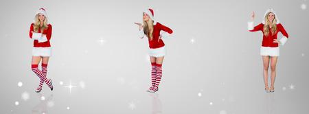 pere noel sexy: Jolie fille � santa tenue avec les bras crois�s contre la vignette gris Banque d'images