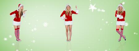 pere noel sexy: Jolie fille � santa tenue soufflant contre vignette verte Banque d'images