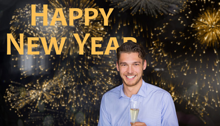 evening wear: Man toasting with champagne against colourful fireworks exploding on black background