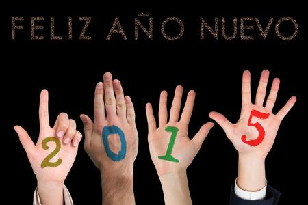 ano: Hands against glittering feliz ano nuevo