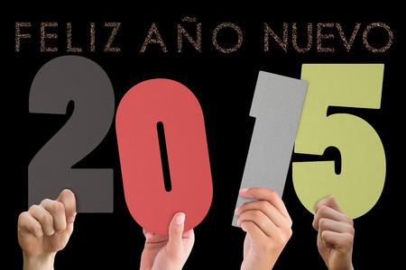 ano: Hands holding poster against glittering feliz ano nuevo Stock Photo