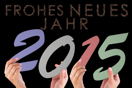 neues: Hands holding poster against glittering frohes neues jahr