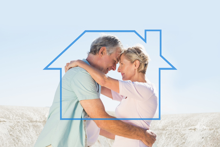 house outline: Happy senior couple embracing on the pier against house outline Stock Photo