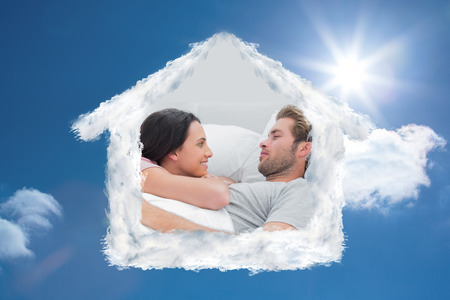 awaking: Couple awaking and looking at each other against bright blue sky with clouds Stock Photo