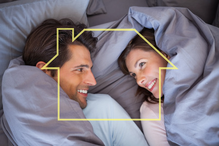 hair wrapped up: Couple having fun wrapped in their blanket against house outline