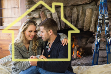 couple lit: Romantic couple in front of lit fireplace against house outline