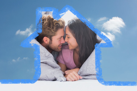 hair wrapped up: Couple wrapped in the duvet against cloudy sky
