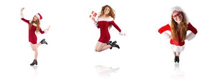 pere noel sexy: Image composite de rousse festive souriant � l'objectif
