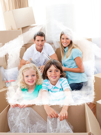 chirpy: Smiling family packing boxes against house outline in clouds Stock Photo