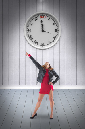 computer dancing: Brunette in red dress and biker jacket against grey room