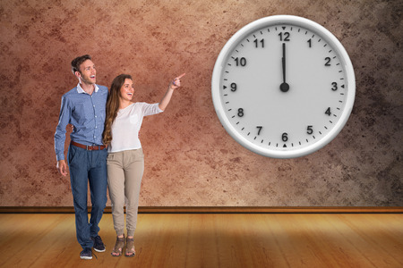 grimy: Full length of couple looking away against grimy room Stock Photo