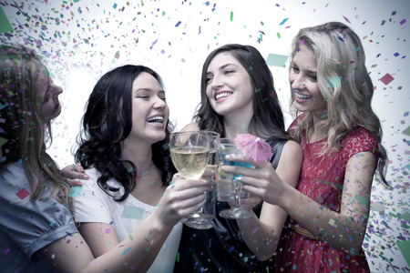 evening wear: Friends with drinks against flying colours Stock Photo