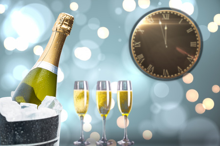 ice bucket: Clock counting down to midnight against champagne cooling in ice bucket