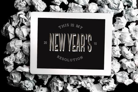 new years resolution: New years resolution against digital tablet on crumpled paper