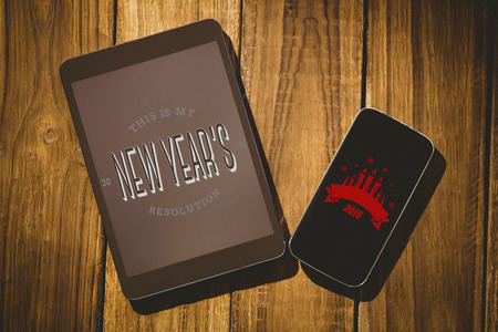 new years resolution: New years resolution against tablet and smartphone on desk