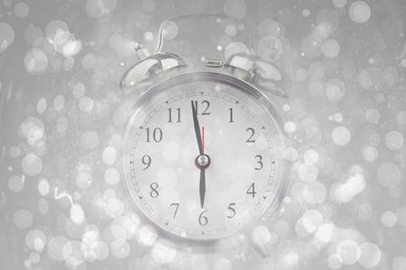 abstract alarm clock: Alarm clock against grey abstract light spot design