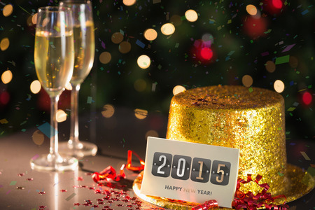 celebratory event: 2015 card on table set for party with gold hat and champagne
