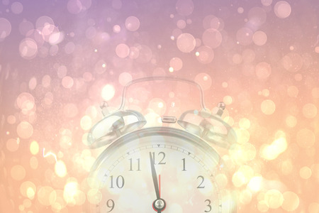 abstract alarm clock: Alarm clock against pink abstract light spot design Stock Photo