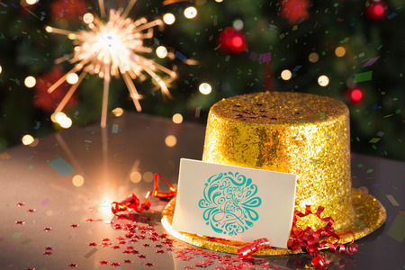 celebratory event: 2015 card on table set for party with gold hat and sparkler Stock Photo