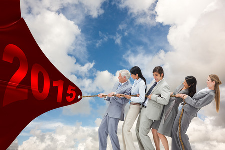tugging: Business people pulling a rope against blue sky with white clouds Stock Photo