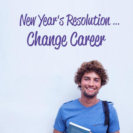 new years resolution: new years resolution against happy student holding book Stock Photo