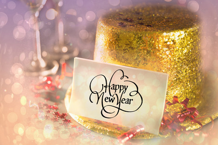 gold flute: Digital composite of Happy new year card leaning on gold party hat