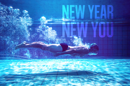 Fit swimmer training by himself against new year new you Standard-Bild